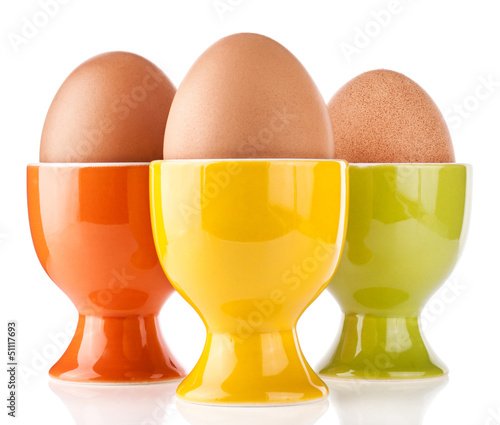 Eggs in color stand isolated on white background