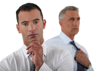 Two businessmen preparing to give important presentation