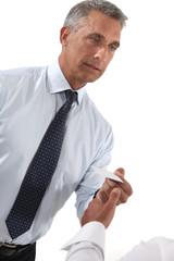 Businessman handing out business card