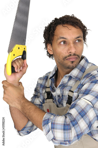 Scared carpenter holding hand-saw