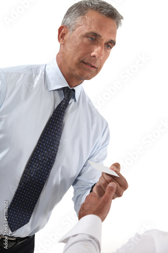 Businessman handing out business card