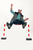 Man jumping over safety barrier