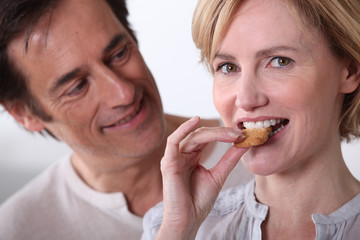 Woman eating cookies