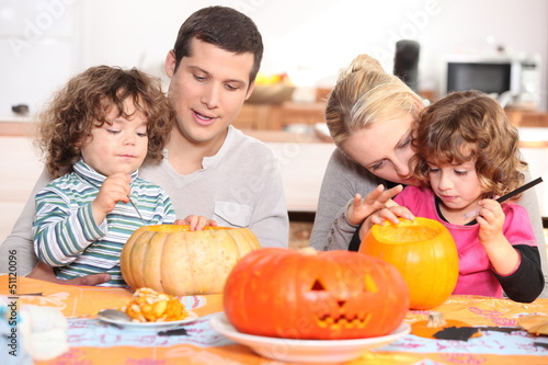 Family decorating pumpkins