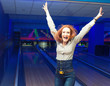 Excited girl in a bowling