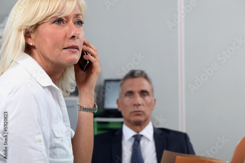 Woman in office with colleague