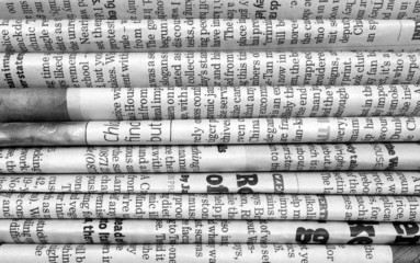 Stack of newspapers in black and white