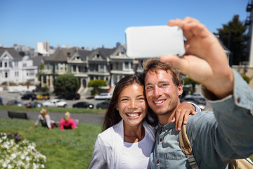 Happy young couple in San Francisco Alamo Square