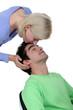 Woman kissing boyfriend on forehead