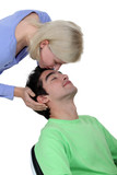 Woman kissing boyfriend on forehead