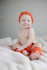 baby wearing costume of pumpkin