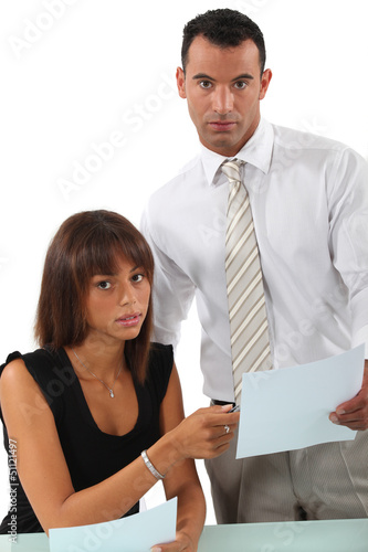 Business couple going over paperwork