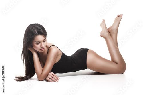 A beautiful lying woman in a black swimsuit