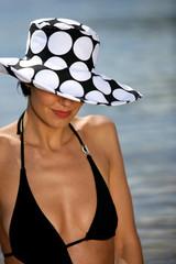 Seductive brunette at the beach