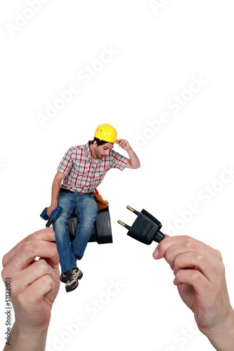 Electrician sitting on a plug