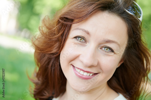 Smiling adult woman at spring outdoors