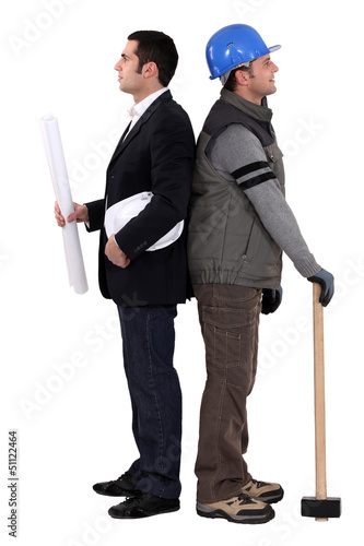 Architect and construction worker standing back to back