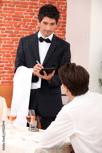 a waiter working at restaurant