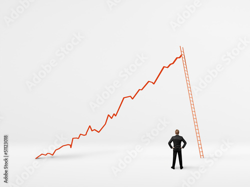 man looking at the growth of his business
