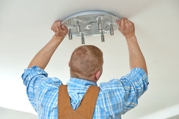 Electrician at wiring work in home