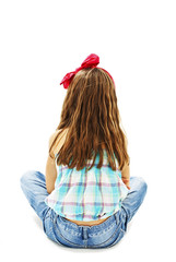Rear view of little girl sitting on floor