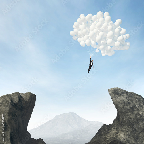 businessman flying on balloons