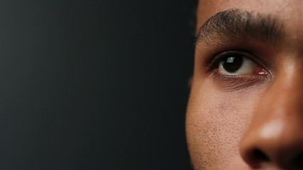 Close up of African American man's eyes, looking up