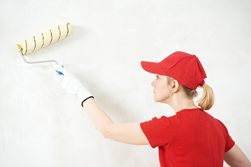 woman painter at indoor work