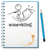 A notebook with a sketch of a person waterskiing
