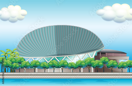 A stadium surrounded with trees