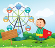 A boy in the hill with a wooden signboard  and a ferris wheel at