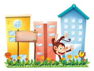 A monkey in the garden with a wooden signboard