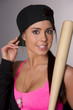 Pretty Female Baseball Lover Adjusts Hat Holding Wooden Bat