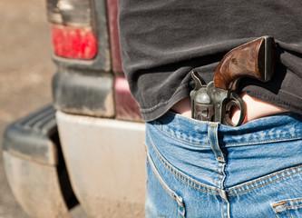 Pistol Tucked into Jeans