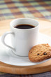 A cup of coffee with some cookies