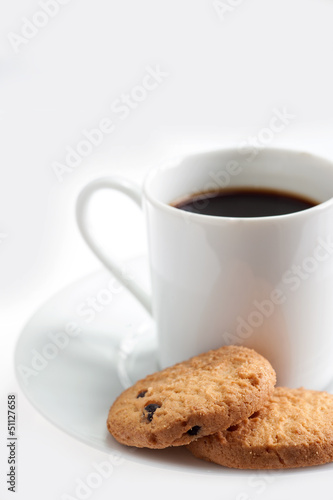 A cup of coffee with some cookies on white background