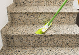 brush cleaning the stairs marble