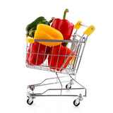Shopping trolley full of pepper on white background