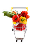 Shopping trolley full of vegetables on white background