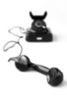 Vintage black telephone on white
