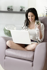 Woman using her laptop at home