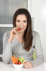Beautiful girl eating healthy food