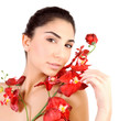 Pretty girl with red orchid flowers