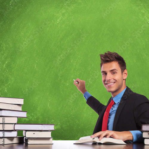 man prepares to write