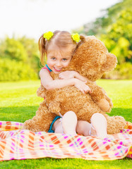 Happy girl with teddy bear