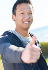Happy Asian Man Showing Thumb Up Sign