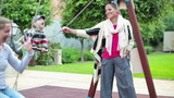 Happy girlfriends on playground with son, steadicam shot