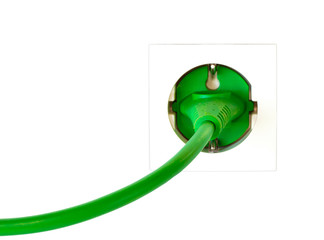 Green power plug in simple wall outlet