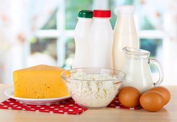 Dairy products and eggs on napkin on table in kitchen