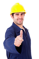 Smiling young builder thumbs up on white background